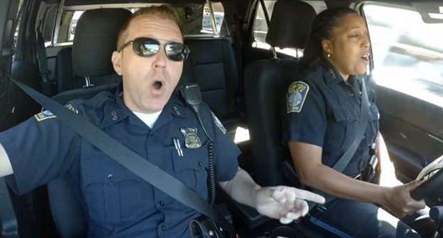 Officers sing patriotic tune in 'Cop Pool Karaoke': God Bless America